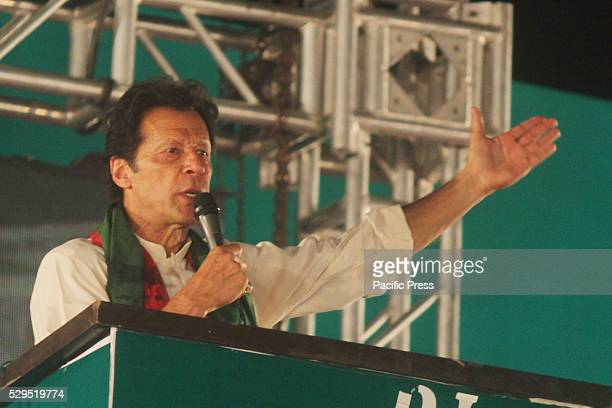 Imran Khan cricketerturnedpolitician and chairman of the Opposition and political party Pakistan TehreekeInsaf party addresses his supporters during...