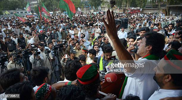 Imran Khan head of political party Pakistan TehreekeInsaf addresses a byelection rally in Peshawar on August 18 2013The Election Commission of...