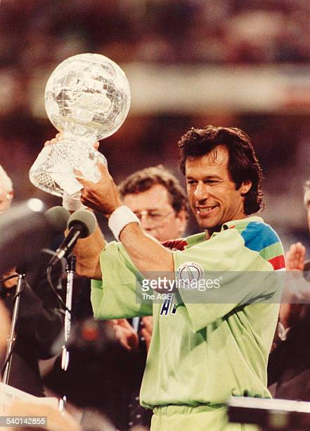 Imran Khan holds aloft the World Cup trophy after Pakistan's 22run win against England in the Cricket World Cup final at the MCG 25 March 1992 Neg No...