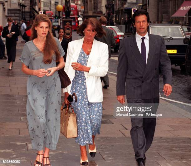 Imran Khan is joined by his wife Jemima and her mother Lady Annable Goldsmith as they arrive at the High Court in London today for the ongoing libel...