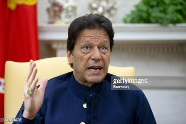Imran Khan, Pakistan's prime minister, speaks during a meeting with U.S. President Donald Trump, not pictured, in the Oval Office of the White House...