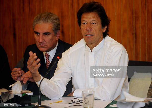 Imran Khan the cricket star turned politician and his party leader former foreign minister Shah Mehmood Qureshi attend a party meeting in Islamabad...