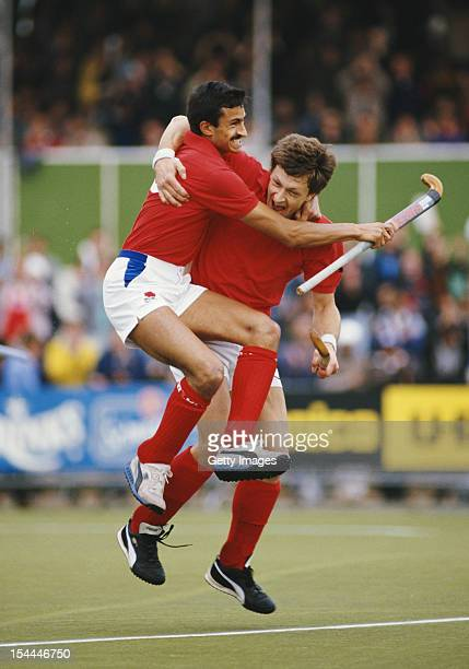 Imran Sherwani and Sean Kearly of England celebrate after their victorious semi final match against West Germany at the 6th FIH Men's Field Hockey...