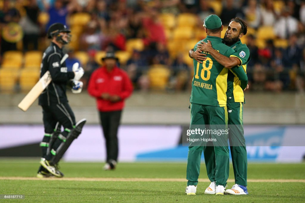 Imran Tahir and Faf du Plessis of South Africa celebrate the wicket of Lockie Ferguson of New Zealand during game three of the One Day International series between New Zealand and South Africa at Westpac Stadium on February 25, 2017 in Wellington, New Zealand.