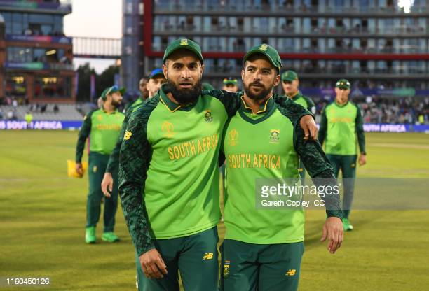 Imran Tahir and JP Duminy of South Africa leave the field for the final time in International Cricket during the Group Stage match of the ICC Cricket...