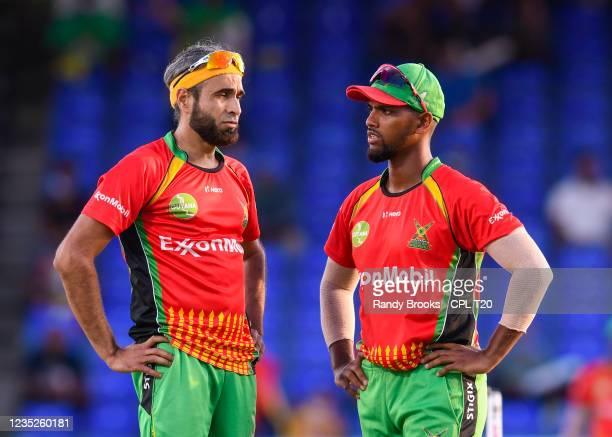 Imran Tahir and Nicholas Pooran of Guyana Amazon Warriors during the 2021 Hero Caribbean Premier League Play-Off match 32 between Guyana Amazon...