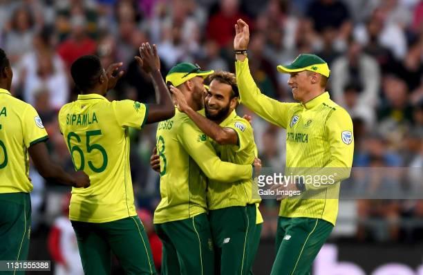 Imran Tahir and team mates of South Africa celebrate the wicket of Kamindu Mendis of Sri Lanka during the 1st KFC T20 International match between...