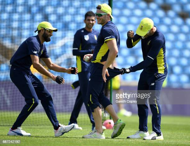 Imran Tahir David Miller and Faf du Plessis of South Africa share a joke during a nets session at Headingley on May 23 2017 in Leeds England
