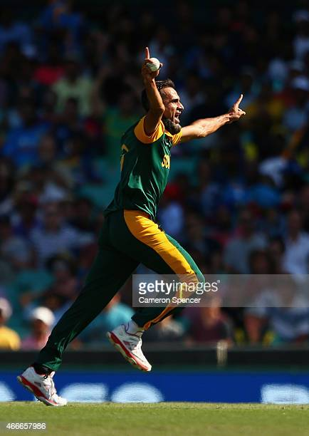 Imran Tahir of South Africa celebrates catching out Lahiru Thirimanne of Sri Lanka off his own delivery during the 2015 ICC Cricket World Cup match...