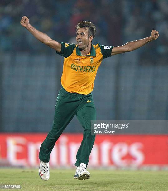 Imran Tahir of South Africa celebrates dismissing Colin Munro of New Zealand during the ICC World Twenty20 Bangladesh 2014 Group 1 match between New...