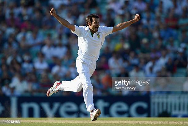 Imran Tahir of South Africa celebrates dismissing England captain Andrew Strauss during day four of the 1st Investec Test match between England and...