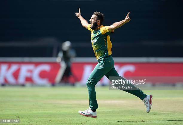 Imran Tahir of South Africa celebrates dismissing Joe Root of England during the 2nd KFC T20 International match between South Africa and England at...