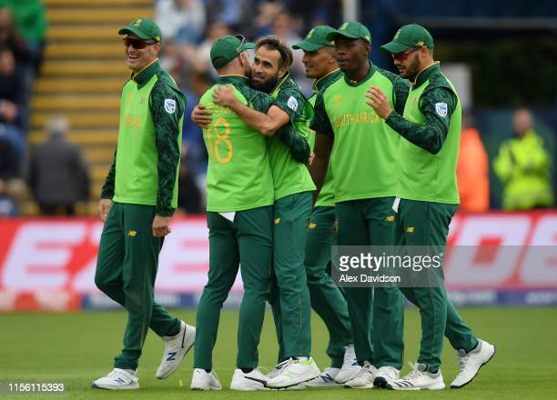 Imran Tahir of South Africa celebrates taking the catch and wicket of of Asghar Afghan of Afghanistan with his teammates during the Group Stage match...