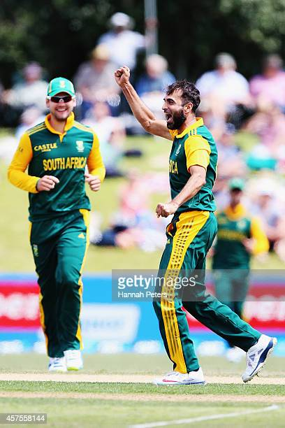 Imran Tahir of South Africa celebrates the wicket of Daniel Vettori of New Zealand during the One Day International match between New Zealand and...