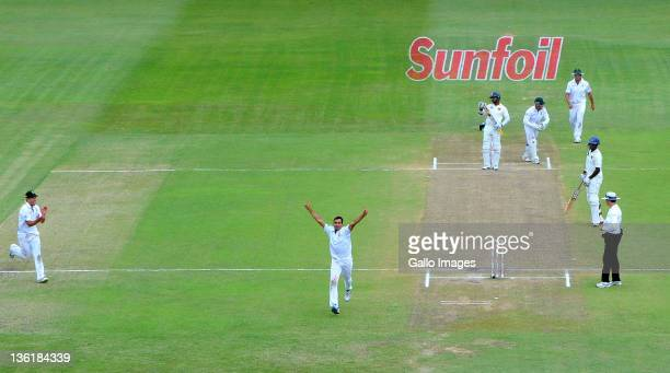 Imran Tahir of South Africa celebrates the wicket of kumar Sangakkara of Sri Lanka for 108 runs during day 3 of the 2nd Sunfoil Test match between...