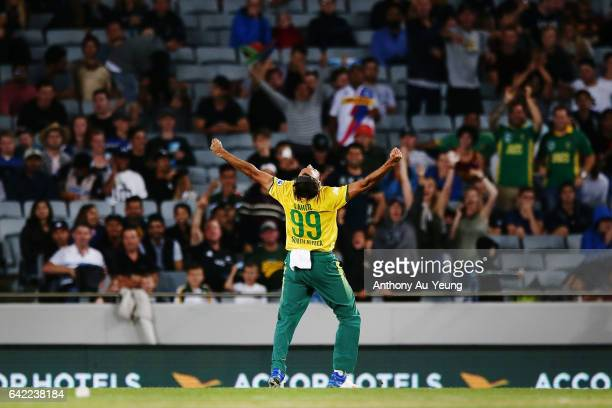 Imran Tahir of South Africa celebrates the wicket of Luke Ronchi of New Zealand during the first International Twenty20 match between New Zealand and...