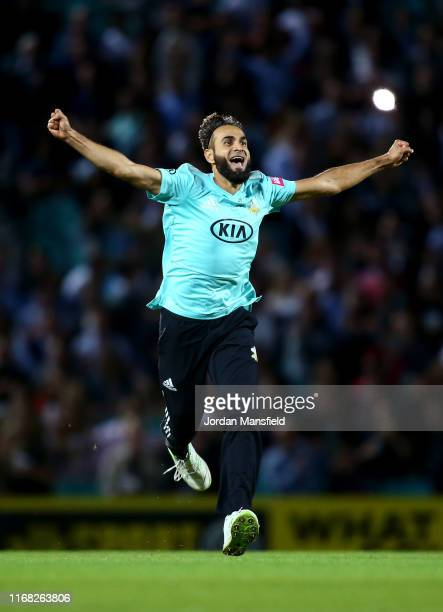 Imran Tahir of Surrey celebrates dismissing Delray Rawlins of Sussex during the Vitality T20 Blast match between Surrey and Sussex at The Kia Oval on...