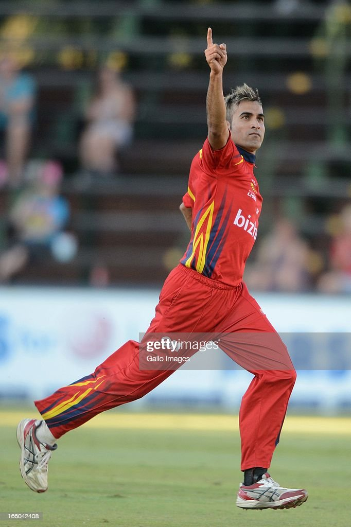 Imran Tahir of the Bizhub Highveld Lions celebrates the wicket of Roelof van der Merwe during the 2013 RAM Slam T20 Challenge Final between Bizhub Highveld Lions and Nashua Titans at Bidvets Wanderers Stadium on April 07, 2013 in Johannesburg, South Africa.