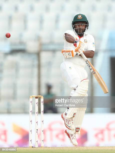 Imrul Kayes of Bangladesh fends off a rising delivery from Pat Cummins of Australia during day four of the Second Test match between Bangladesh and...
