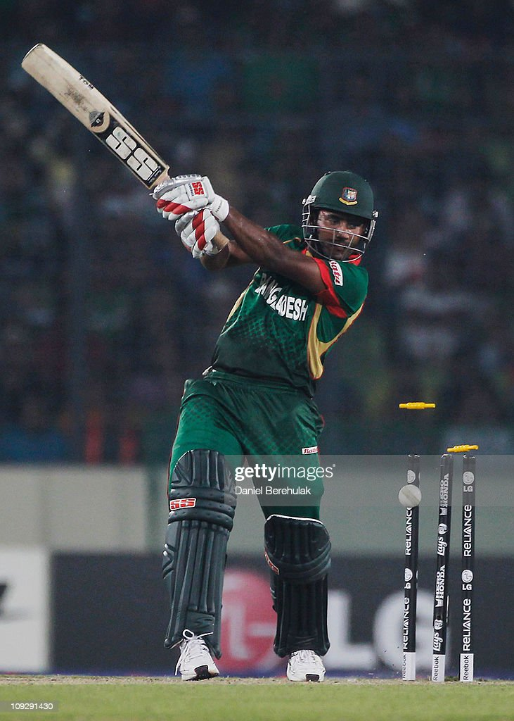 Imrul Kayes of Bangladesh is bowled by Munaf Patel of India during the opening game of the ICC Cricket World Cup between Bangladesh and India at the Shere-e-Bangla National Stadium on February 19, 2011 in Dhaka, Bangladesh.