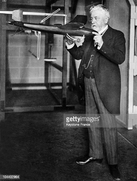 In 1889 Gustave EIFFEL the constructor of the eponymous Tower pictured examining an airplane model in his aeronautic laboratory in Auteuil