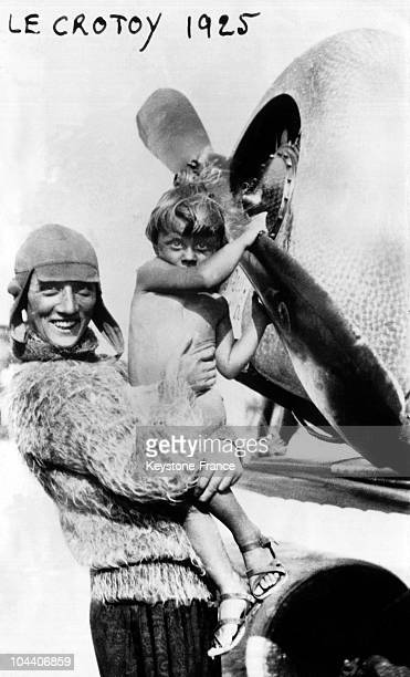 In 1925n at Crotoy in the Somme French pilot Adrienne BOLLAND showing her plane to her 3yearold son