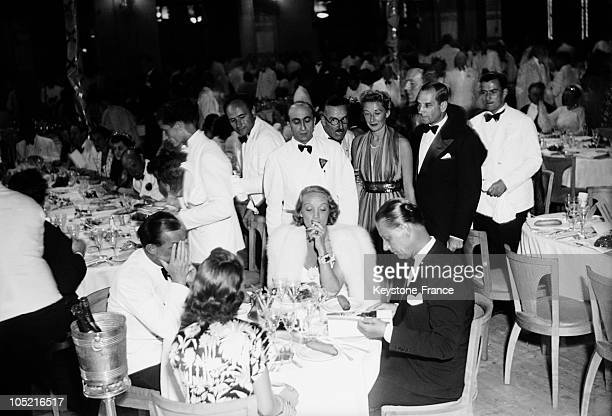 In 1938 Actress Marlene Dietrich Dines With Her Husband Rudolf Sieber And The German Writer Erich Maria Remarque In A Restaurant In The Cote D'Azur