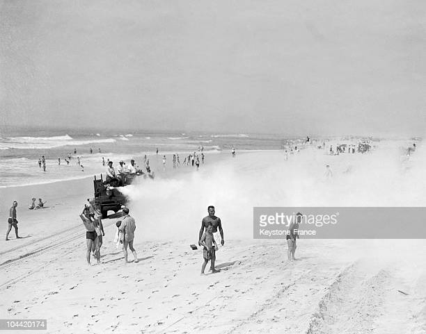 In 1945 A Truck Spraying Ddt On Jones Beach Long Island To Eliminate Mosquitoes The People On The Beach Do Not Seem Worried About The Toxicity Of DDT...