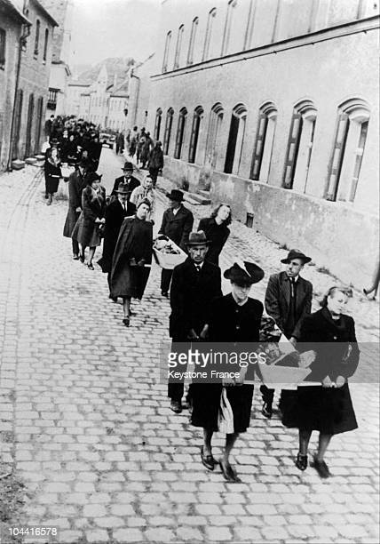 In 1945 German civilians carry the bodies of concentration camp victims to the city's cemetery near the BergenBelsen extermination camp in Germany
