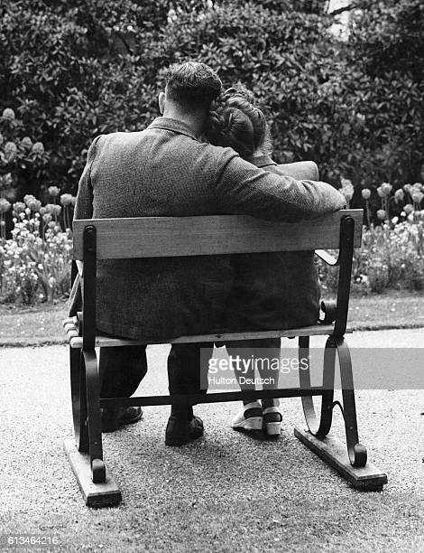 In 1948 smaller twoperson park benches were installed in London parks to give couples more privacy One such bench is used by a couple in Battersea...