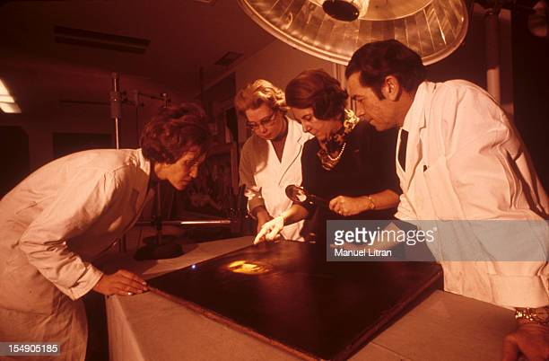 In 1968 the laboratory and the restoration workshop of the Louvre museum in Paris The chief curator of the museum HOURS Magdalene examining a...