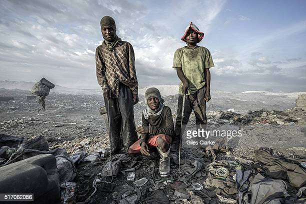 In a 200acreplus dump 5 kilometers north of Haitis capital PortauPrince hundreds of men women and children scavenge day and night through the burning...