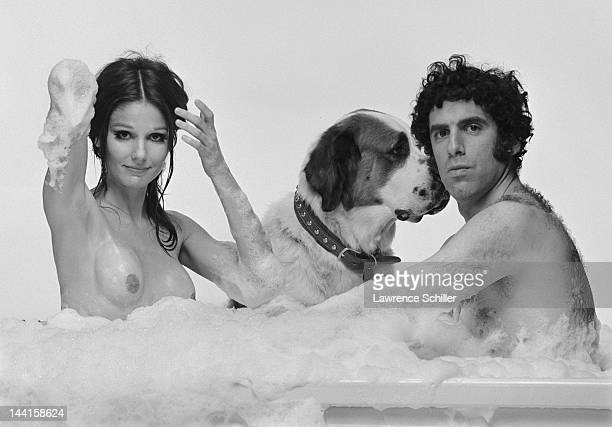 In a a promotional portrait for their film 'Move' American actors Paula Prentiss and Elliott Gould along with a dog pose in a bubble bath Los Angeles...