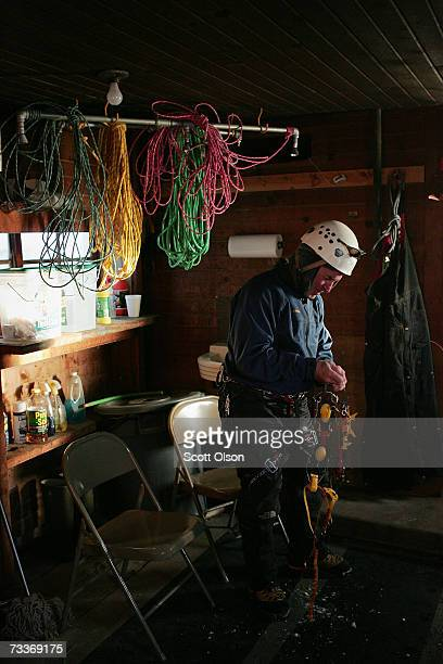 In a barn converted into an iceclimbing office Don Briggs prepares his gear before climbing icecovered grain silos February 18 2007 in Cedar Falls...