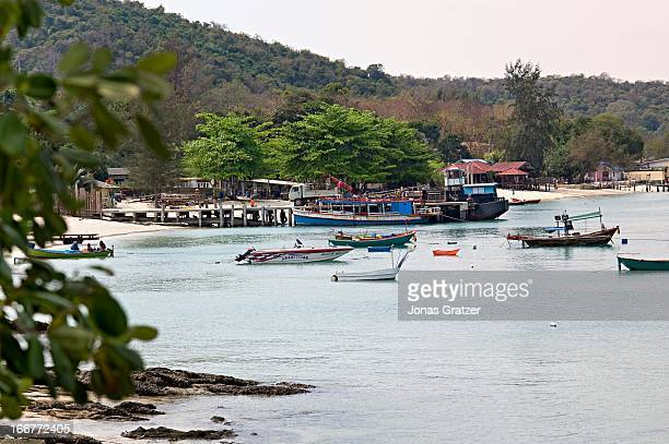 In a bay on Koh Samet Island fishing boats and speed boats are moored