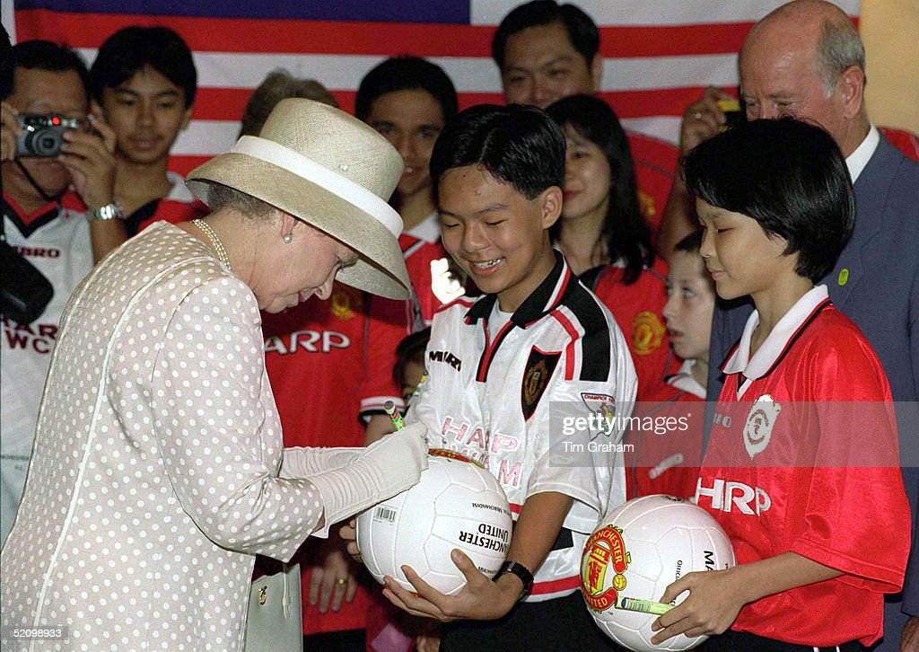 Queen Signs Football : News Photo