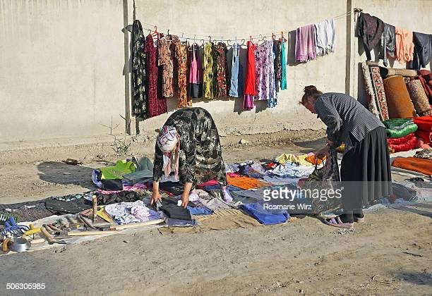 CONTENT] In a Bukhara suburban area once a week there is a local market where everybody sells and buys used clothes and various other items