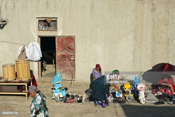 CONTENT] In a Bukhara suburban area weekly flea market where sundry used items are sold Women offering shoes clothes and toys