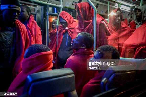 In a bus rescued migrants being transferred to the Red Cross tent On 11 November 2018 in Malaga Spain The Maritime Spanish Vessel SAR Mastelero...