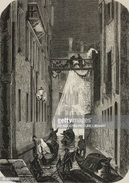 In a canal at night some gondolas carry dressedup people during the Carnival of Venice Italy illustration after a drawing by G Stella from the...