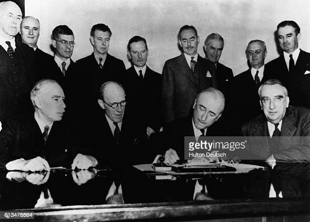 In a ceremony at the Department of State, the $4 billion British Loan Agreement was formally signed. Pictured during the signing are, left to right:...