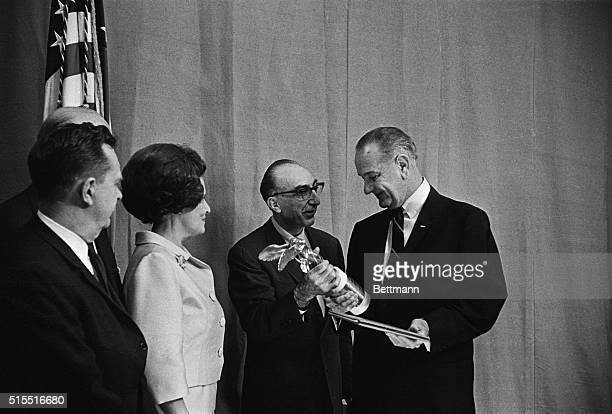 In a ceremony at the White House President Johnson receives the Albert Lasker special award for this outstanding contribution to the health of the...