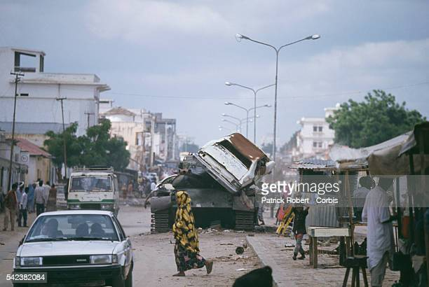 In a city torn by clan violence drought and hunger Somalis go about their daily business on a street in Mogadishu before the arrival of 28000 United...