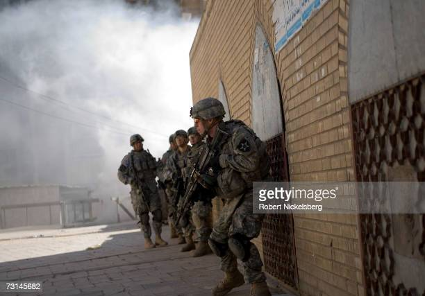 In a combined effort to disrupt Sunni insurgents and Shia militias US Army soldiers from 1st Platoon Bravo Company 3/2 Stryker Brigade Combat Team...
