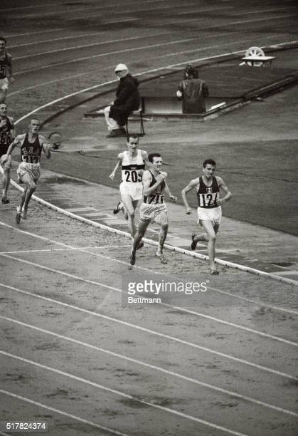 In a comefrombehind stretch run Bob Schul of the USA wins the 5000 meter race Schul is shown passing Michael Jazy of France Jazy is eventually passed...