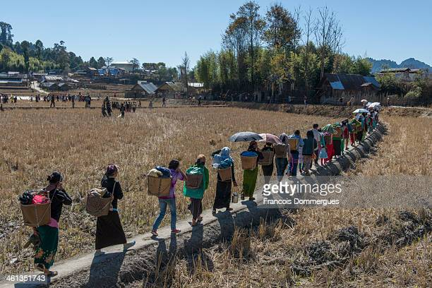 In a countyside village in the vicinity of Ziro, Anurachal Pradesh, villagers of the Apatani tribe have gathered to celebrate: a baabao -ceremonial...