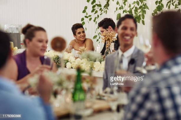 in a crowded room she only has eyes for him - guest stock pictures, royalty-free photos & images