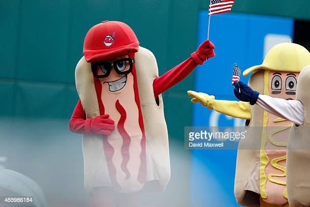 In a display of patriotism mascots cary American flags during the hot dog race between innings during the game between the Cleveland Indians and the...