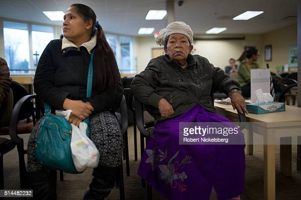 In a doctor's office Hema Gurung sits with her motherinlaw Man Maya Gurung as they for an appointment Burlington Vermont February 3 2016 Members of...