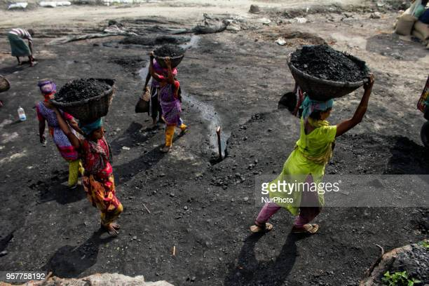In a domestic port at capital's Pagla area workers are loading a coal in a truck in Dhaka Bangladesh on 12 May 2018